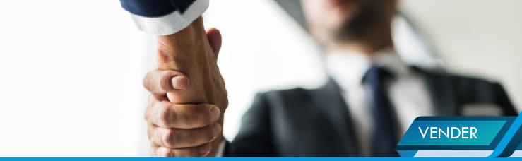 Imagen de dos ejecutivos dándose la mano para cerrar un acuerdo de venta.